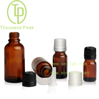 TP-2-18 amber glass bottle with tamper evident cap and orifice reducer
